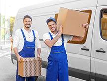 Delivery Men With Moving Boxes